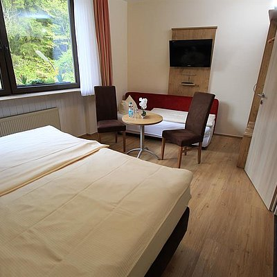 Foto: Familienzimmer Standard Doppelzimmer (Zusatzbett)