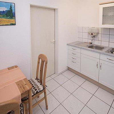 Foto: Küchenzeile und Essbereich