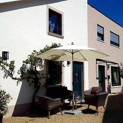 Foto: Ferienhaus - Eingang zur Wohnung mit Innenhof